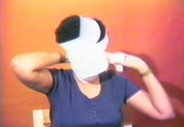 "A still from Howardena Pindell's ""Free, White and 21."""